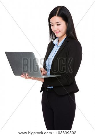 Asian businesswoman use of the laptop computer