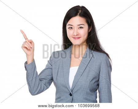 Young businesswoman showing finger up