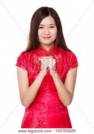 Chinese woman with prayer gesture for blessing lucky