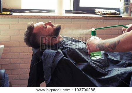 handsome man with mustache and beard in barbershop