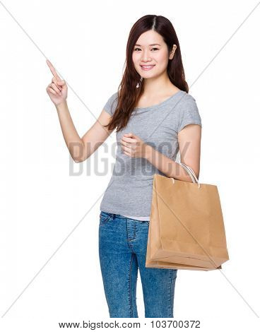 Asian woman hold with shopping bag and finger point up