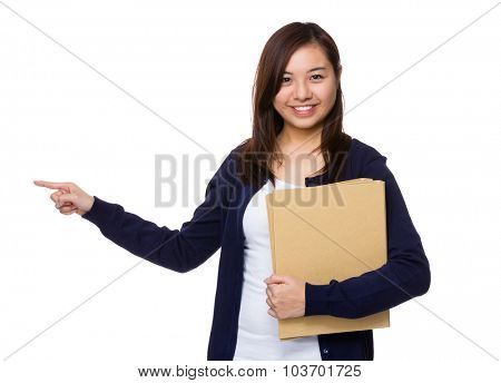 Young woman hold with folder and finger point aside
