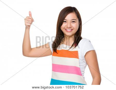 Asian housewife with thumb up