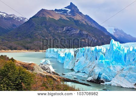 Los Glaciares National Park in Argentina. Sunny summer day.  Colossal Perito Moreno glacier in Lake Argentino