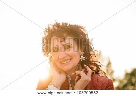 Sunny joyful mature woman portrait