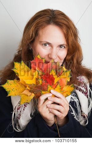Young Woman With Colorful Autumn Maple Leaves