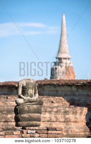 Small Buddha Statue And Ancient Chedi At Wat Mahathat Temple, Ayutthaya, Thailand