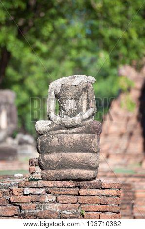 Small Broken Buddha Statue At Wat Mahathat Temple, Ayutthaya, Thailand