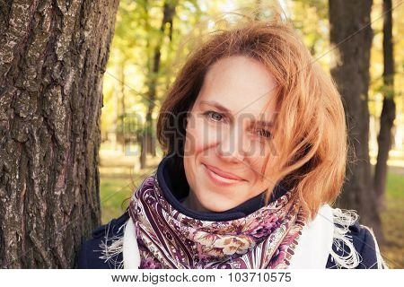 Young Smiling Caucasian Woman In Park