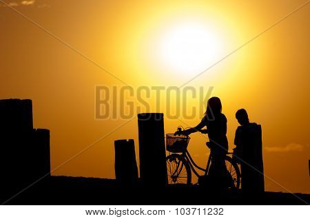 People at sunset on U bein bridge, Taungthaman lake, Amarapura, Burma.