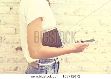 Hipster Girl With Cell Phone And Book
