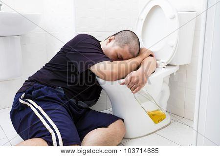 Drunk Fat Man With Wine Bottle In Toilet