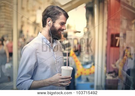 Happy man holding a soft drink
