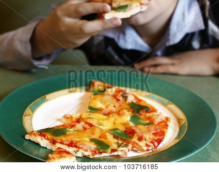 Pizza Cut With Pesto Green Cheese On The Plate
