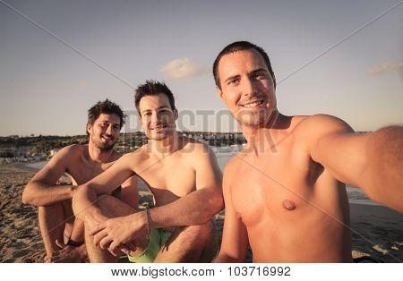 Three friends doing a selfie at the beach