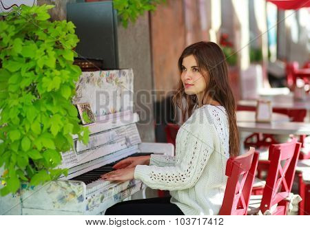 Dreamy Girl Playing On An Old Piano In Street Cafe