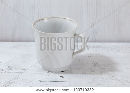 white cup on wooden table