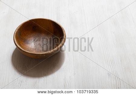 empty wooden bowl on white table