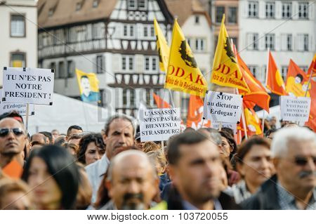 STRASBOURG FRANCE - OCT 4 2015 Demonstrators protesting against Turkish President Recep Tayyip Erdogan's visit to Strasbourg - crowd waving flags and placards in Place Kleber