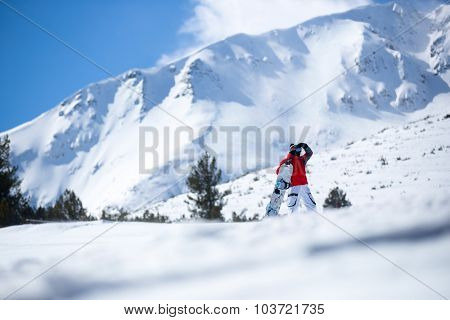 sportsman with snowboard standing
