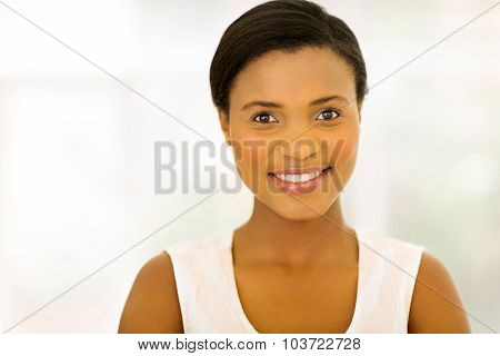 close up portrait of beautiful african american woman indoors