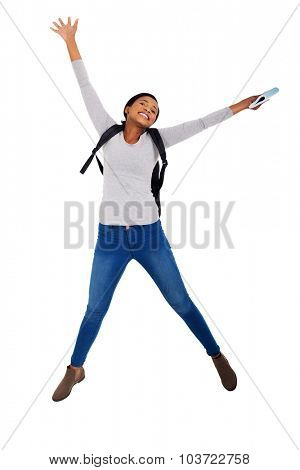 energetic african college student jumping for joy