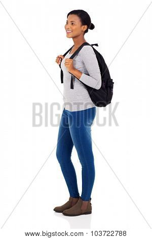 side view of african female college student isolated on white background