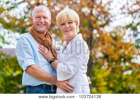 Senior man and woman, husband and wife, embracing each other in love