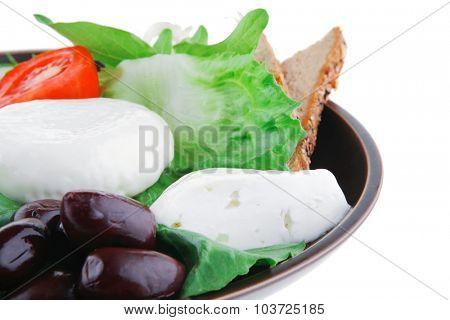 soft mozzarella served with bread on dark plate