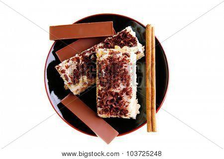 lemon cake and dark chocolate bars on black saucer
