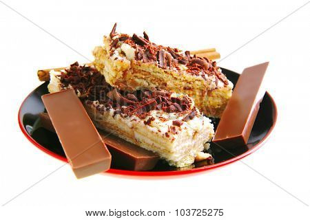lemon cake with chocolate on red black saucer