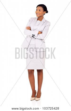 happy african woman with arms crossed standing on white background