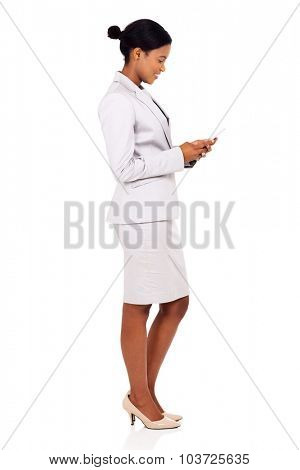 side view of happy african business woman using cell phone isolated on white