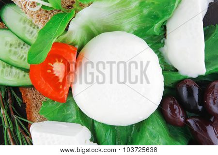 mozzarella cheese with olives and bread on dish