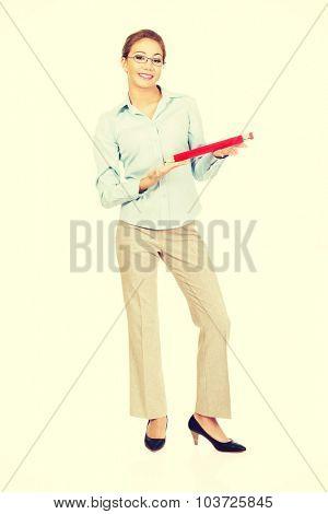 Happy businesswoman holding big pencil.