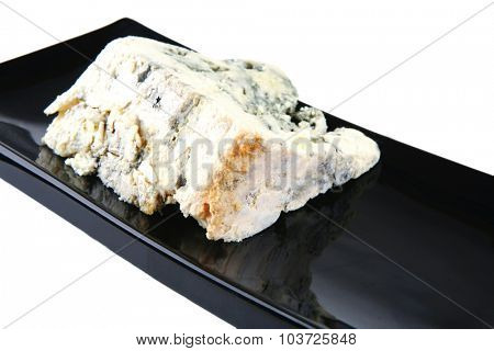 french gorgonzola soft cheese on black plate