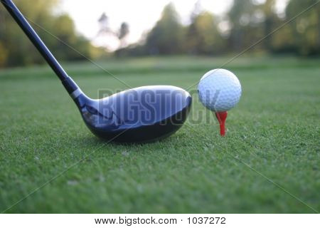 Golf Ball And Driver On Course