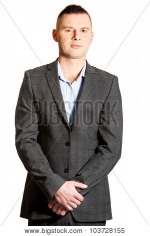 Confident young businessman with clenched hands.