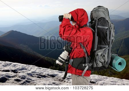 Equipped With The Traveler Photographer In The Red Jacket On The Slope Of The Mountains Looking Thro