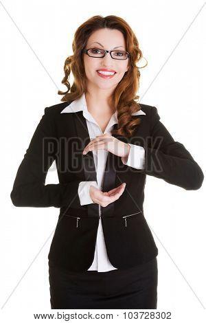 Happy beautiful business woman presenting copyspace in hands.