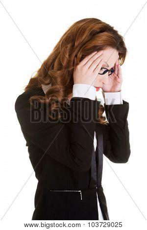 Businesswoman suffering from huge headache.