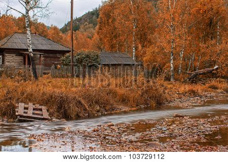 Autumn at mountain village with river