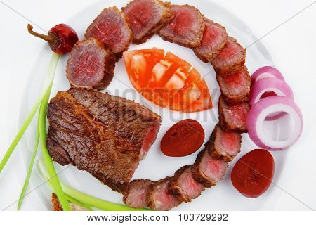 meat food : grilled fat meat served on white plate with tomatoes , sprouts and bread isolated on white background