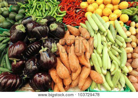 fresh raw vegetables red hot chili pepper green pepper lemons on market
