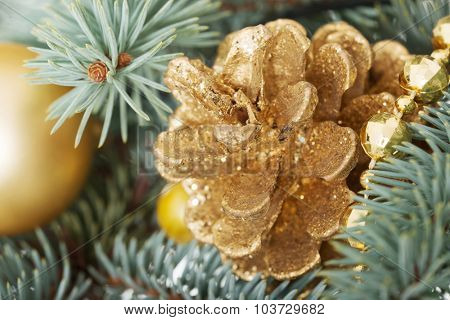 Christmas decorations- pine, balls on a tree. Over green background.