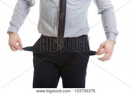 Handsome businessman showing his empty pockets.