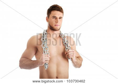 Well build young male model with chains over his neck.