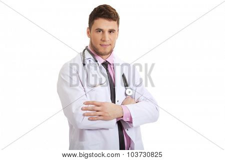 Young happy confident male doctor with folded arms.