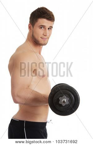 Young muscular sports man exercising with weights.