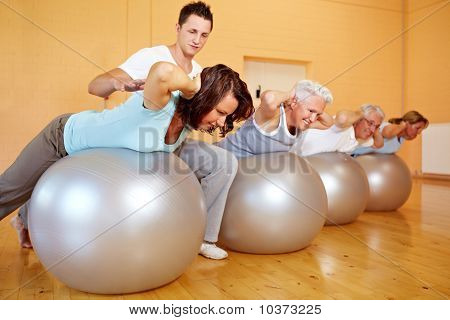 Fitness Trainer Teaching Back Exercises